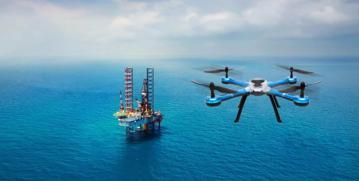 A drone hovering over an oil rig