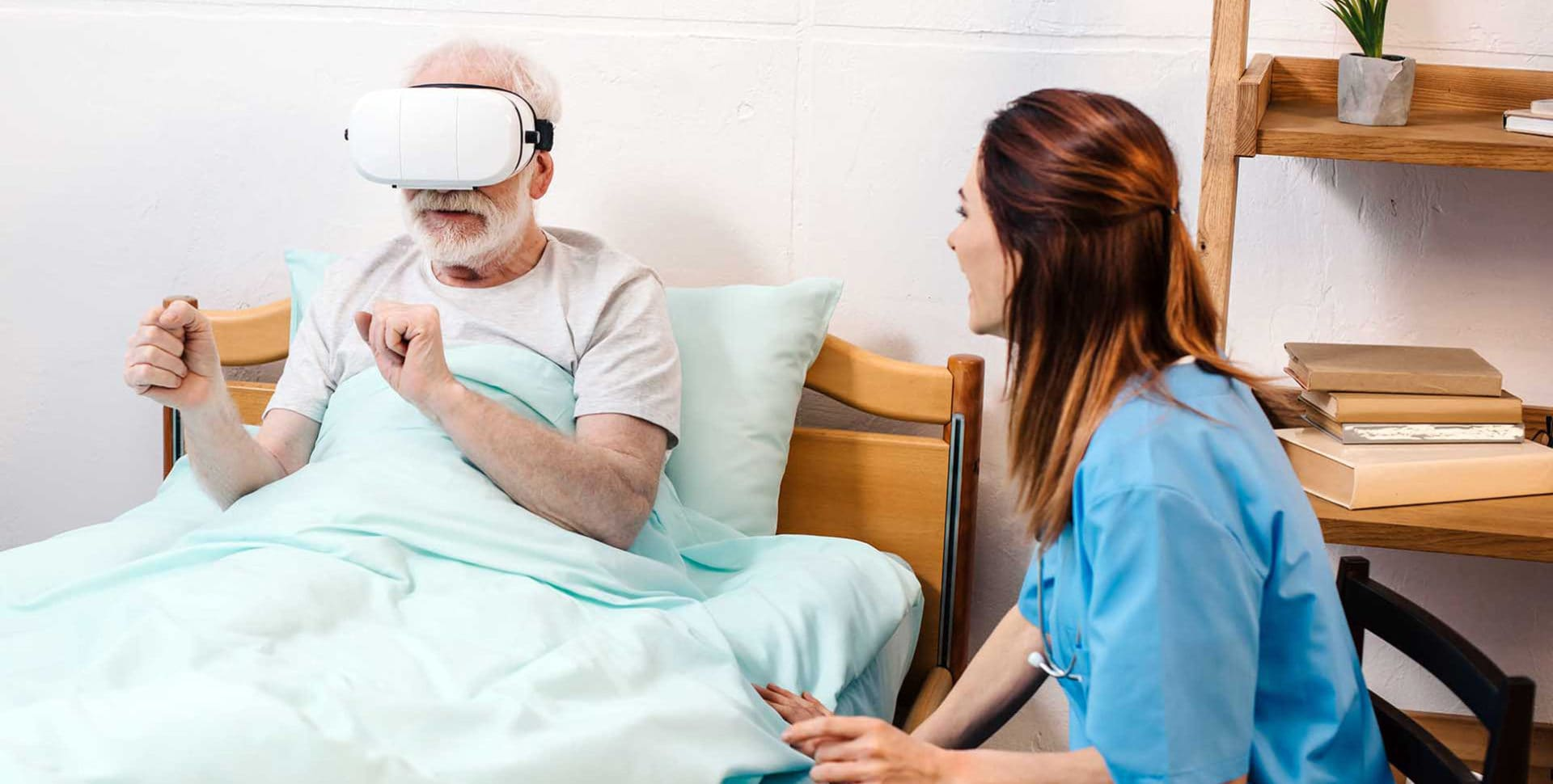 Older man using VR therapy in bed