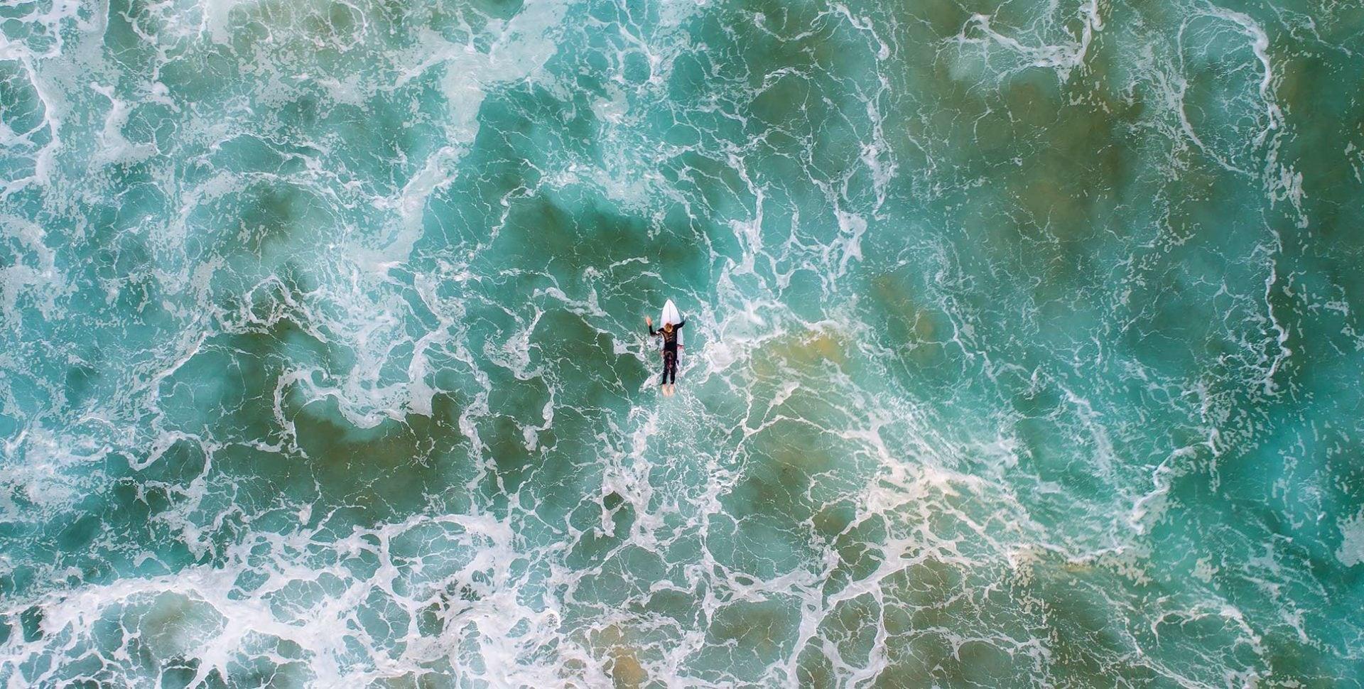 Surfer in rough seas